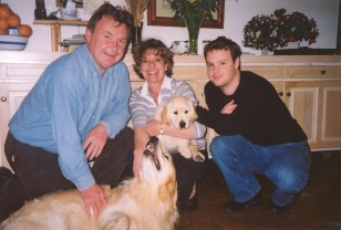 Minette, husband Alec, son Roland, and golden retrievers Benson and Hedges (the puppy).