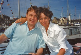 Minette and husband Alec on their boat during a holiday in Normandy, France.